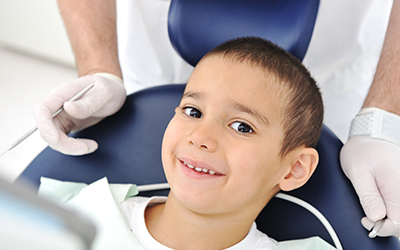 A young boy getting a dental checkup