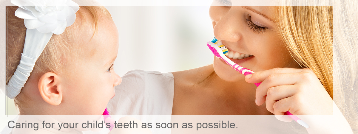 Mother and babay brushing, Caring for your child's teeth as soon as possible.