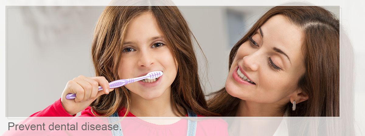 Mother and daugter brushing, Prevent dental disease.