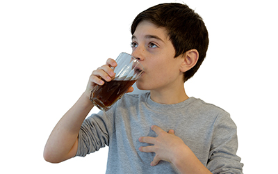 Child drinking soda with dental braces